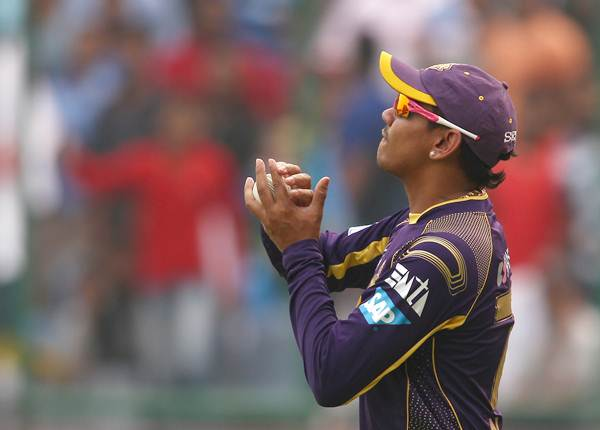 Sunil Narine of the Kolkata Knight Riders takes the catch to get rid of Murali Vijay.