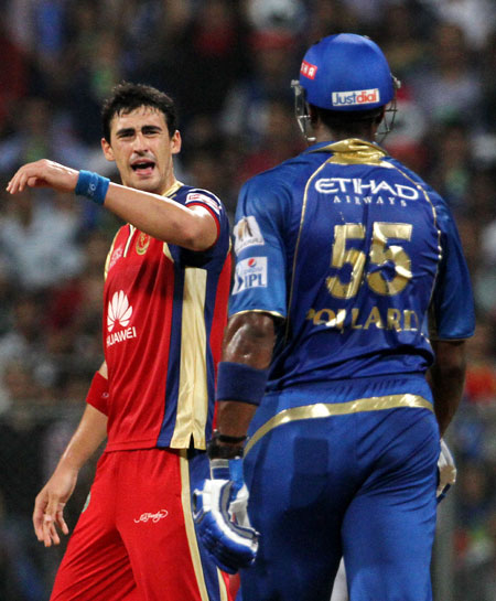 Mitchell Starc of the Royal Challengers Bangalore gestures to Kieron Pollard of the Mumbai Indians