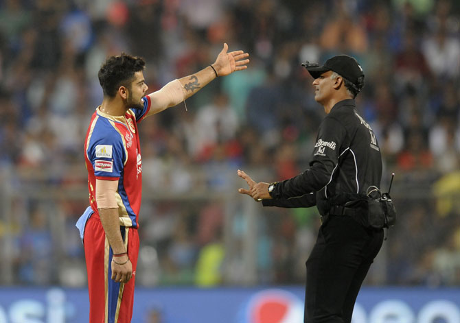 Virat Kohli having a word with the umpire