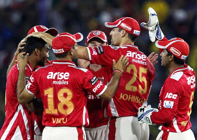 Kings XI Punjab players celebrate the fall of a wicket