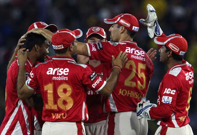 Kings XI Punjab players celebrate a wicket against Chennai Super Kings