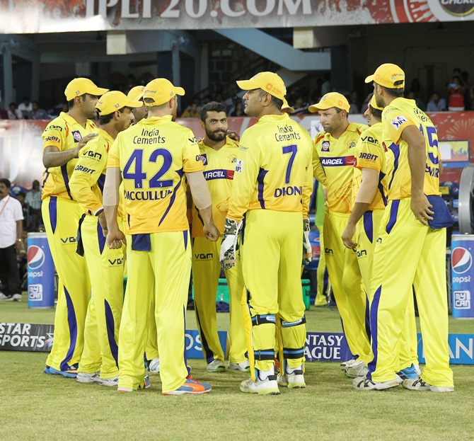 Chennai Super Kings players gather before the start of their match