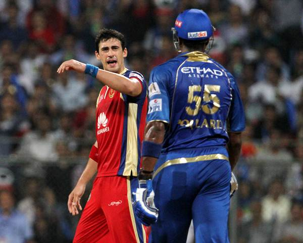 Royal Challengers Bangalore's Mitchell Starc (left) and Mumbai Indians' Kieron Pollard exchange words.