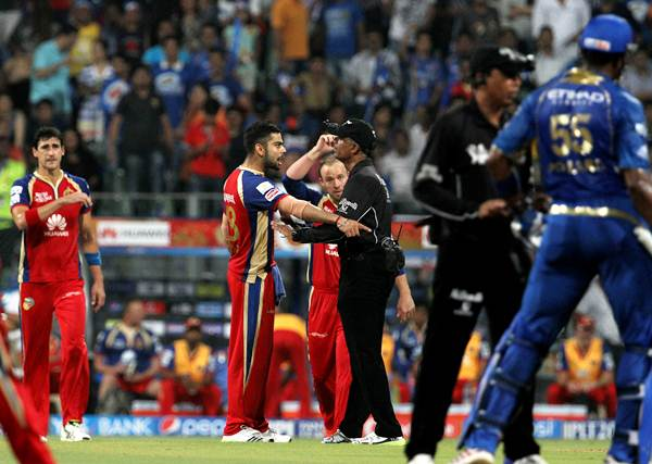 The umpires try to calm down players of both sides after the incident.