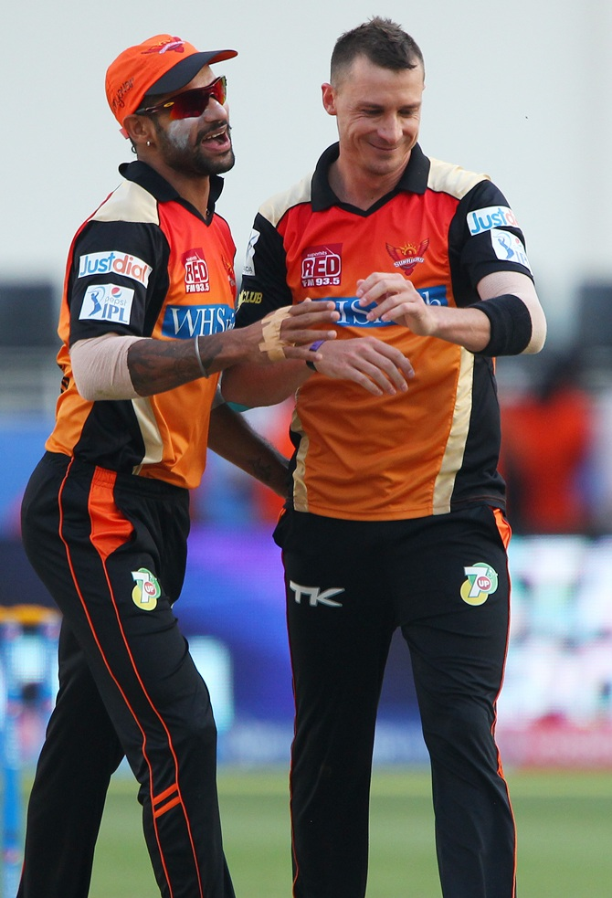 Shikhar Dhawan celebrates with Dale Steyn