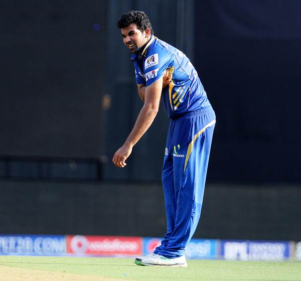 Zaheer Khan grimaces in pain after sending down a delivery in Mumbai Indians' match against Kings XI Punjab on May 3.