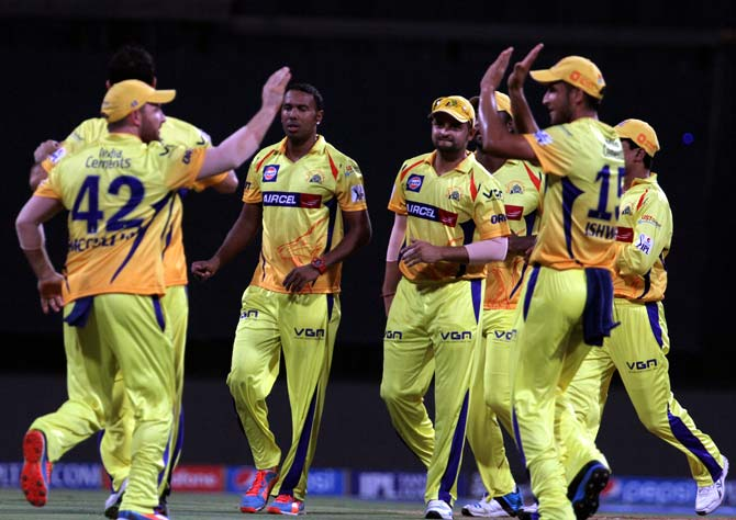 Chennai Super Kings players celebrates after the wicket of CM Gautam