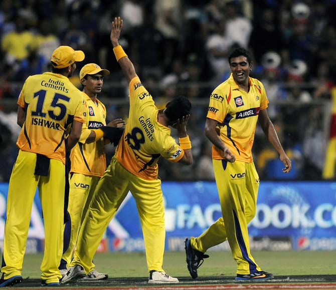 Ravichandran Ashwin (right) celebrates the wicket of Kieron Pollard with his team mates