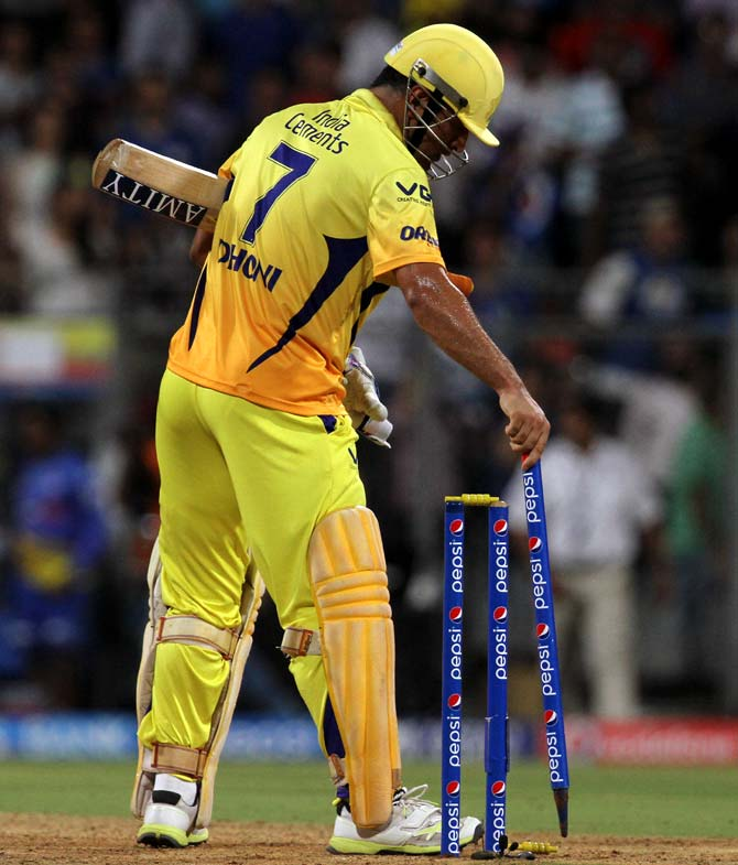Mahendra Singh Dhoni removes the stump after hitting the winning runs for Chennai.
