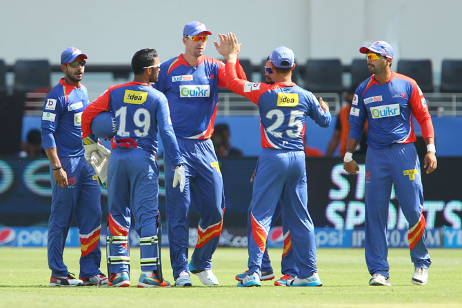 Delhi Dardevils players celebrate a wicket