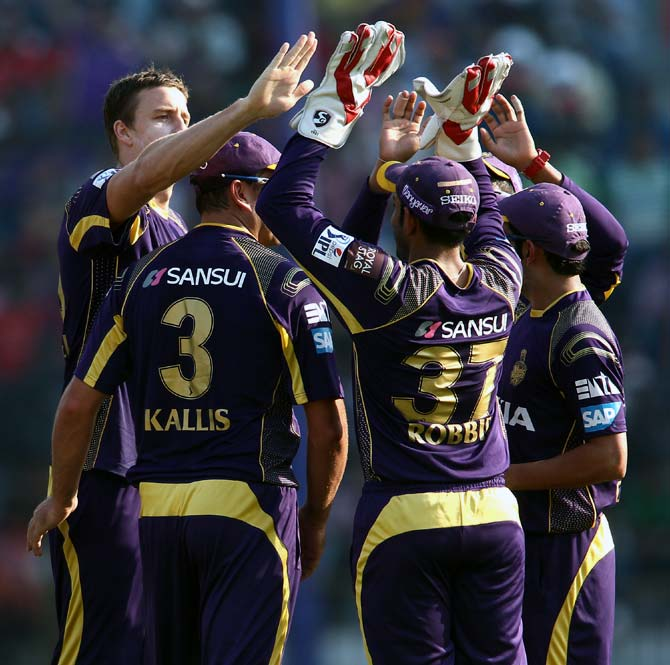 Morne Morkel (left) celebrates a wicket with his team mates.