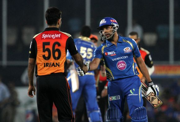 Rohit Sharma shakes hands with Irfan Pathan after winning the game.