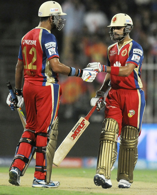 Yuvraj Singh celebrates with Virat Kohli