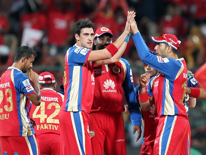 Mitchell Starc and Yuvraj Singh of the Royal Challengers Banglore celebrates wicket of Quinton de Kock of Delhi Daredevils