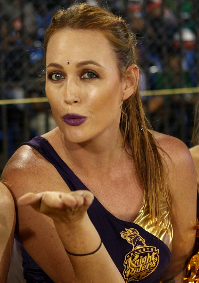 A Kolkata Knight Riders cheerleader blows a kiss