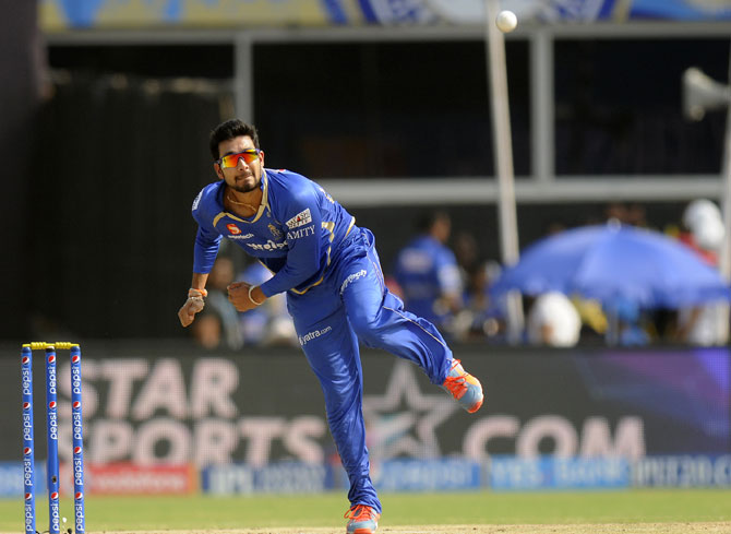 Ankit Sharma of Mumbai Indians bowls