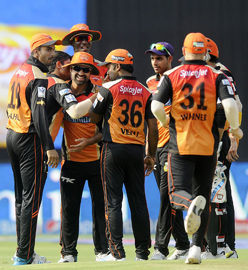 Sunrisers Hyderabad players celebrate the fall of a Bangalore wicket