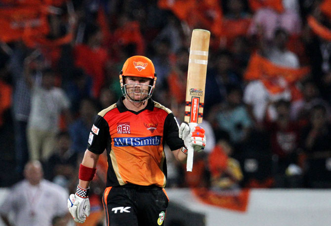 David Warner of the Sunrisers Hyderabad raises his bat after scoring a fifty