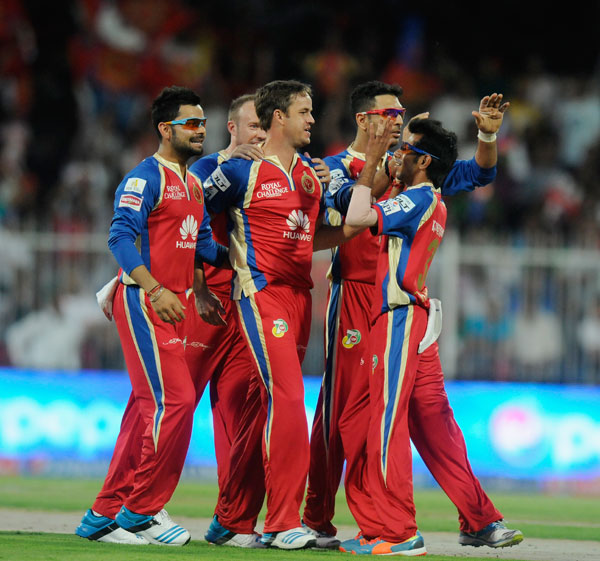 Royal Challengers Bangalore players celebrate a wicket