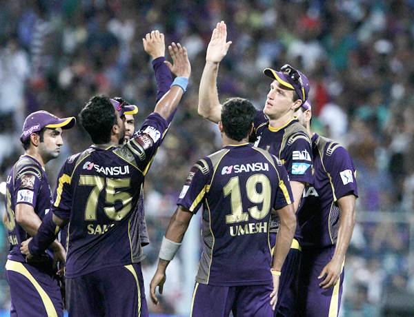 The Kolkata Knight Riders players celebrate after the fall of AB de Villiers's wicket.