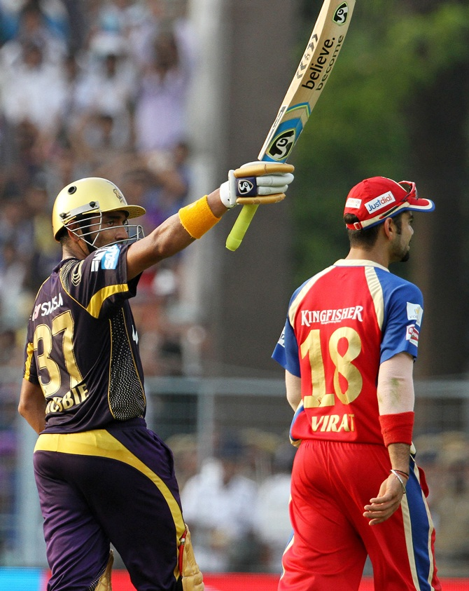 Robin Uthappa (left) celebrates after getting to 50.
