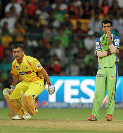 Chennai's MS Dhoni takes a single as RCB's Yuzvendra Singh looks on