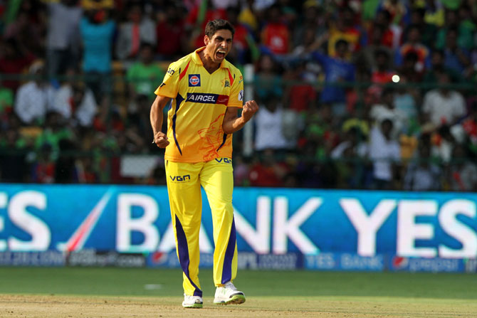 Chennai Super Kings' Ashish Nehra celebrates taking a wicket
