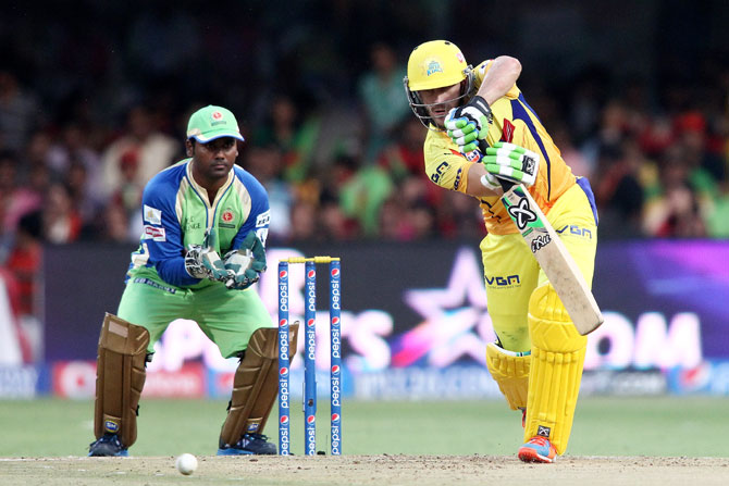 Chennai' Faf du Plessis plays a shot as RCB's Yogesh Takawale looks on
