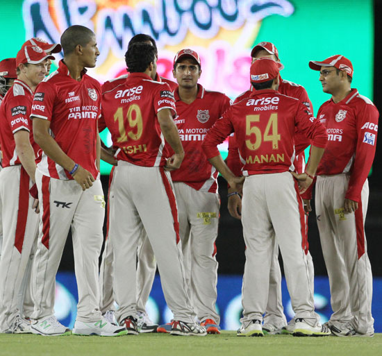 Kings XI Punjab players celebrate the fall of a Rajasthan Royals wicket