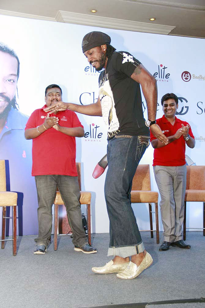 Chris Gayle does the moonwalk during the launch of his shoe brand in Mumbai on Sunday