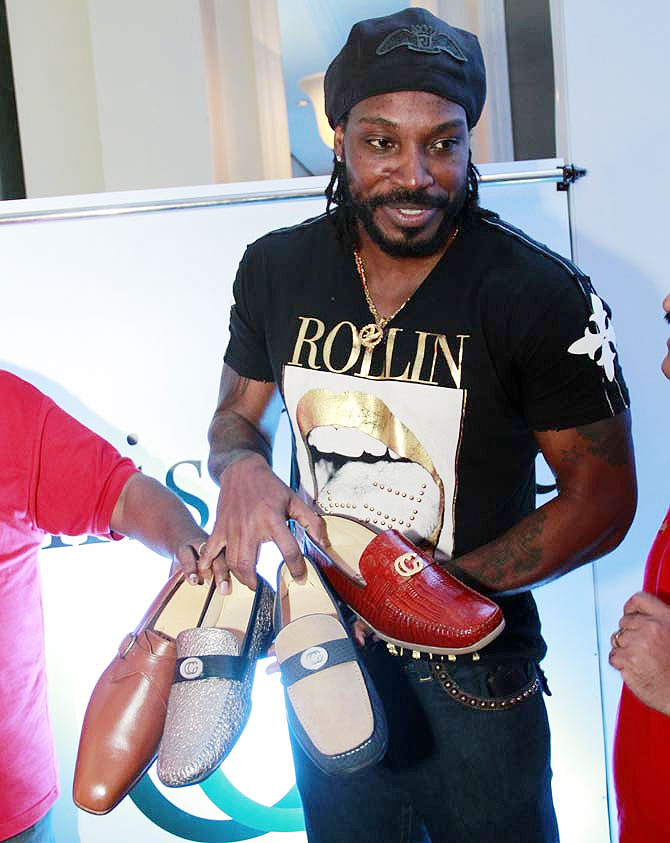 Chris Gayle displays his shoe designs at the launch event in Mumbai on Sunday