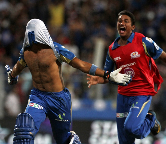 Aditya Tare of Mumbai Indians celebrates.