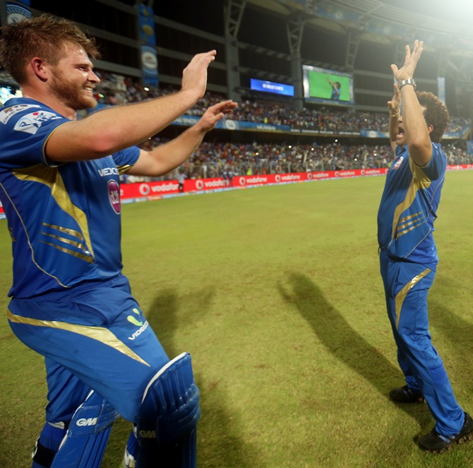 Corey Anderson of the Mumbai Indians and Sachin Tendulkar mentor of Mumbai Indians celebrate