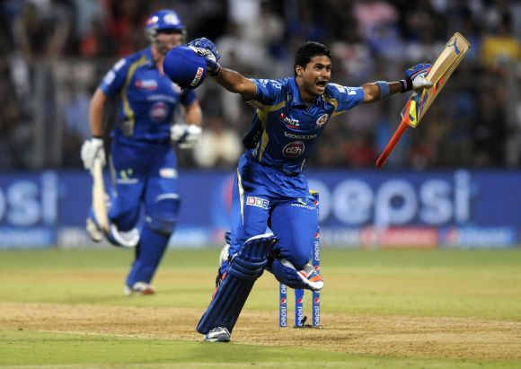 Aditya Tare celebrates after hitting the winning runs