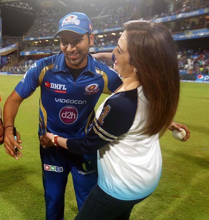 Nita Ambani hugs Mumbai Indians captain Rohit Sharma.