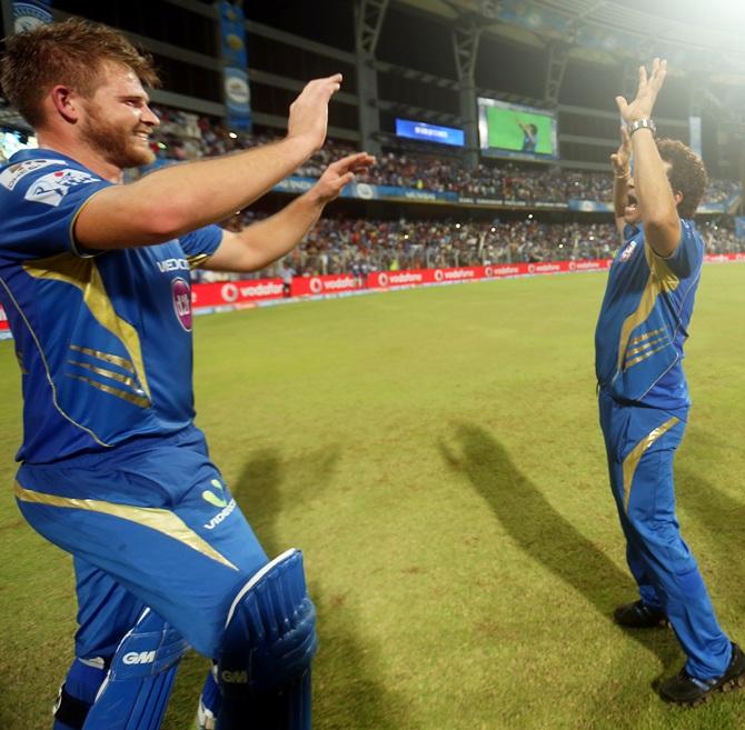 Corey Anderson celebrates with Mumbai Indians mentor Sachin Tendulkar.
