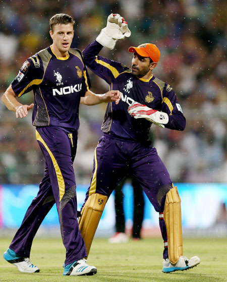 Kolkata's Morne Morkel is congratulated by teammate Robin Uthappa after taking a wicket.