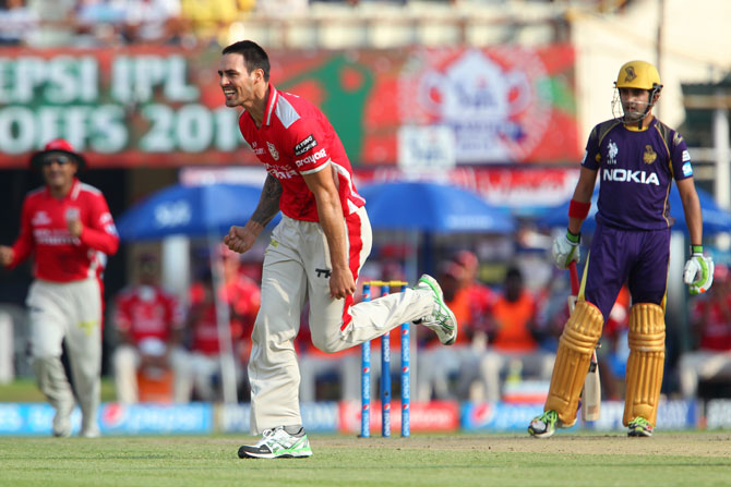 Punjab's Mitchell Johnson celebrates the wicket of Kolkata captain Gautam Gambhir.
