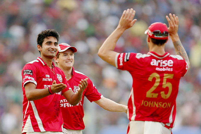 Punjab's Karanveer Singh is congratulated by teammates