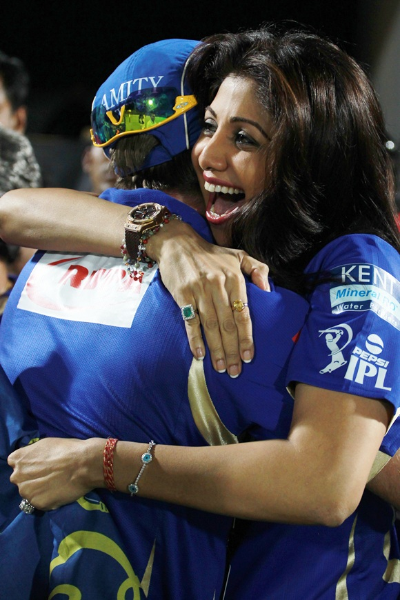 Shilpa Shetty hugs a player.