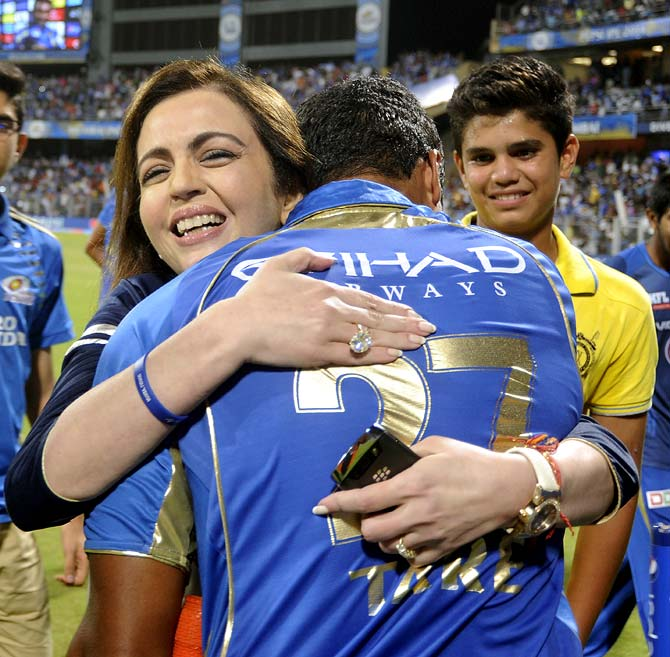 Nita Ambani hugs Aditya Tare as Arjun Tendulkar (right) looks on.