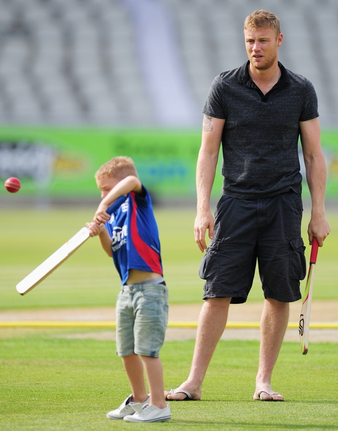 Former Lancashire and England player Andrew 'Freddie' Flintoff looks on as his son Rocky plays a shot
