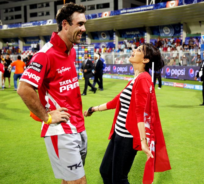 Preity Zinta (right) celebrates with Glenn Maxwell during an earlier match this season