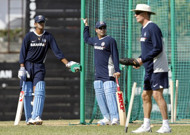 Sachin Tendulkar and Rahul Dravid look on during a practice session