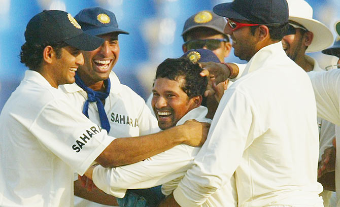 Sachin Tendulkar is congratulated by his teammates after dismissing Pakistani batsman Moin Khan on Day 3 of the 1st Test Match between Pakistan and India at Multan Stadium on March 30, 2004