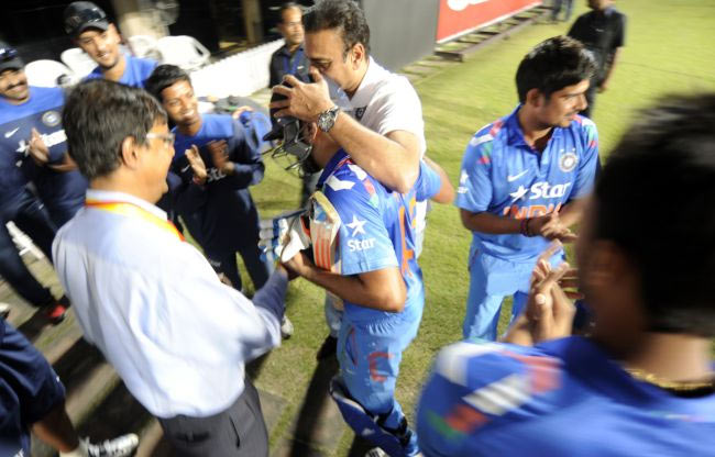 Ravi Shastri, Director of Cricket for the Indian cricket team, congratulates Rohit Sharma at the end of India's innings