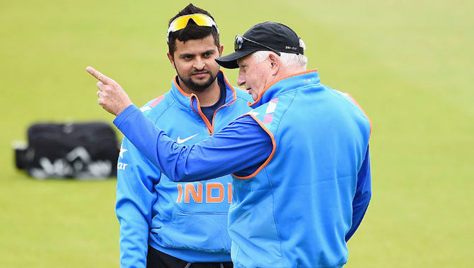 Team India coach Duncan Fletcher talks with Suresh Raina during net practice