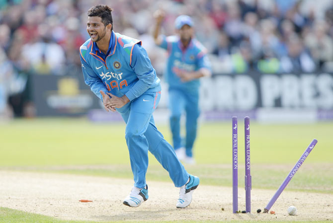 Suresh Raina of India celebrates the run out of Ian Bell of England during the 3rd One-Day International at Trent Bridge on Saturday