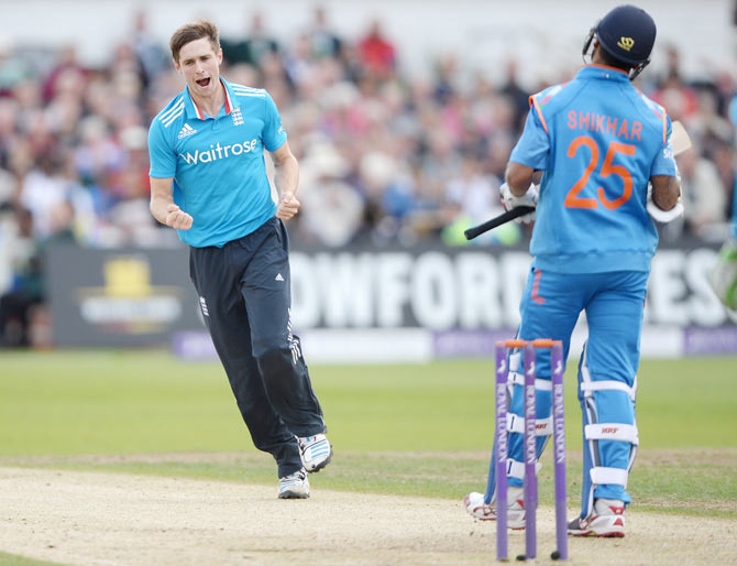 Chris Woakes of England celebrates dismissing Shikhar Dhawan of India during the 3rd One-Day International at Trent Bridge