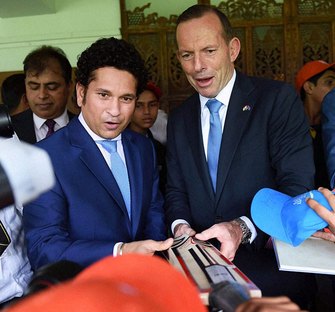 Sachin Tendulkar and Australian Prime Minister Tony Abbott during an interactive session with children at Cricket Club of India (CCI) in Mumbai on Thursday